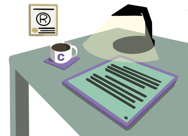 Green and purple desk with e-reader, TM certificate, lamp, and Communer mug